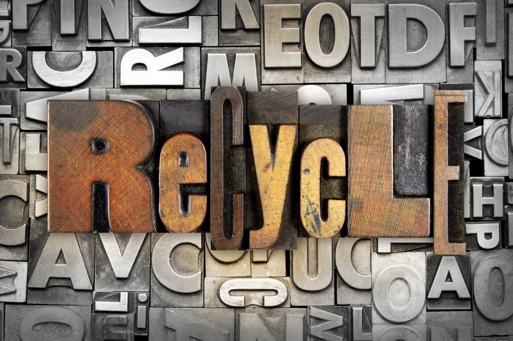The word RECYCLE written in vintage letterpress type