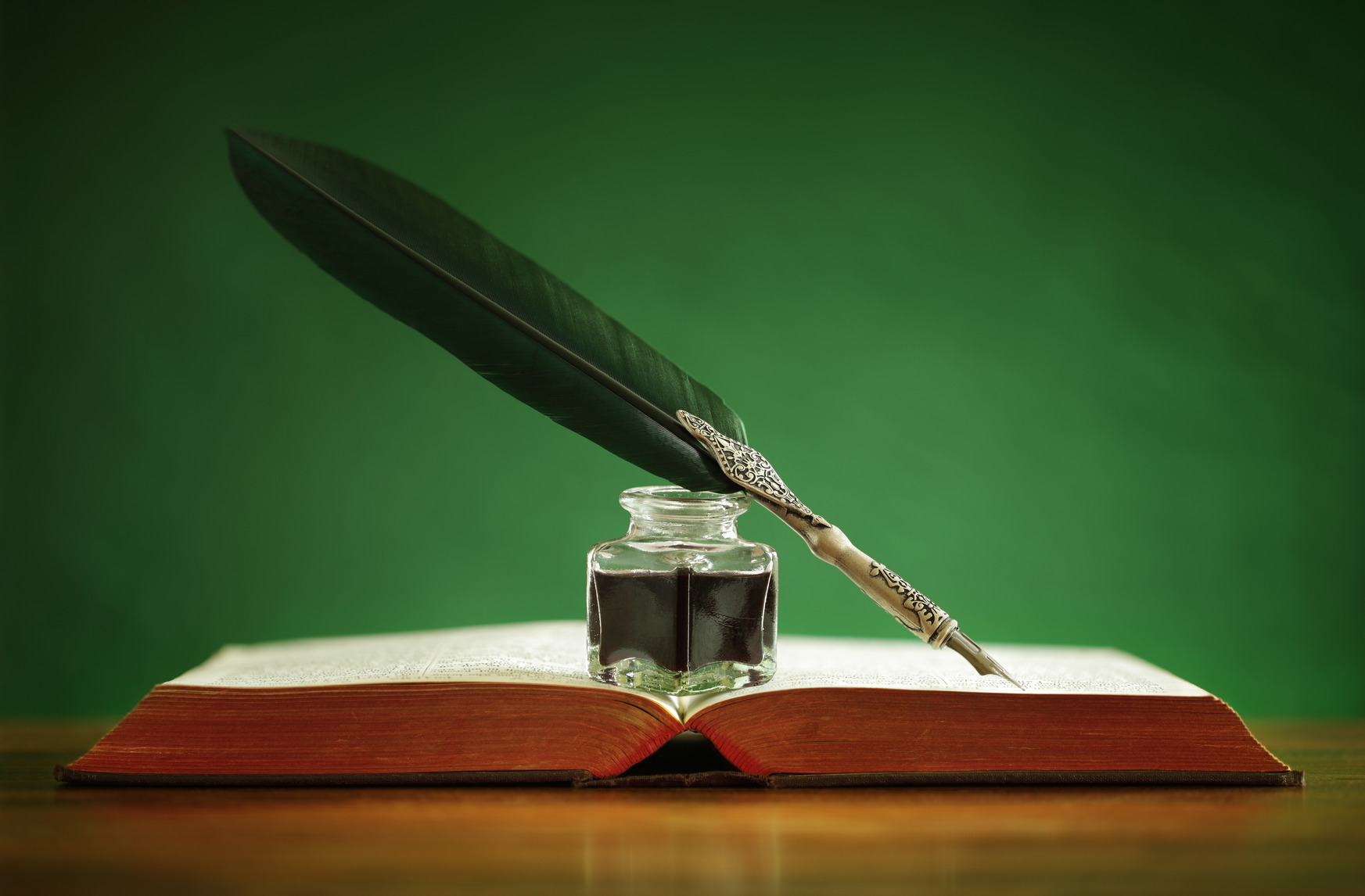 quill-pen-and-inkwell-on-old-book-m